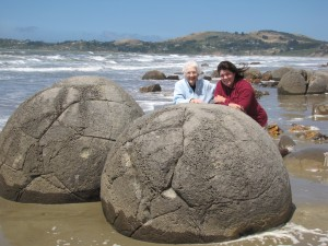 My mother, Sally, and I at Moeraki Boulders in New Zealand